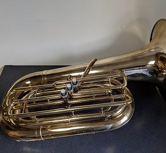 This Conn 12J Tuba is a 3 valve horn that plays well.